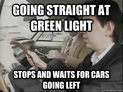 Going straight at green light STOPS and waits for cars going left