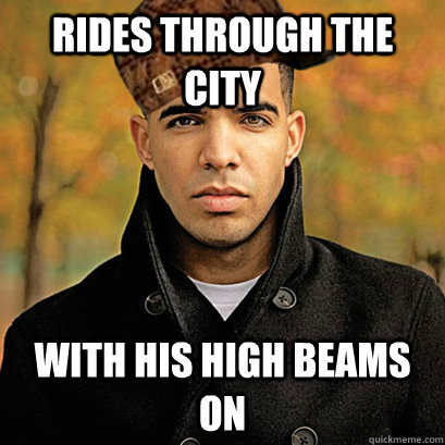Rides through the city with his high beams on