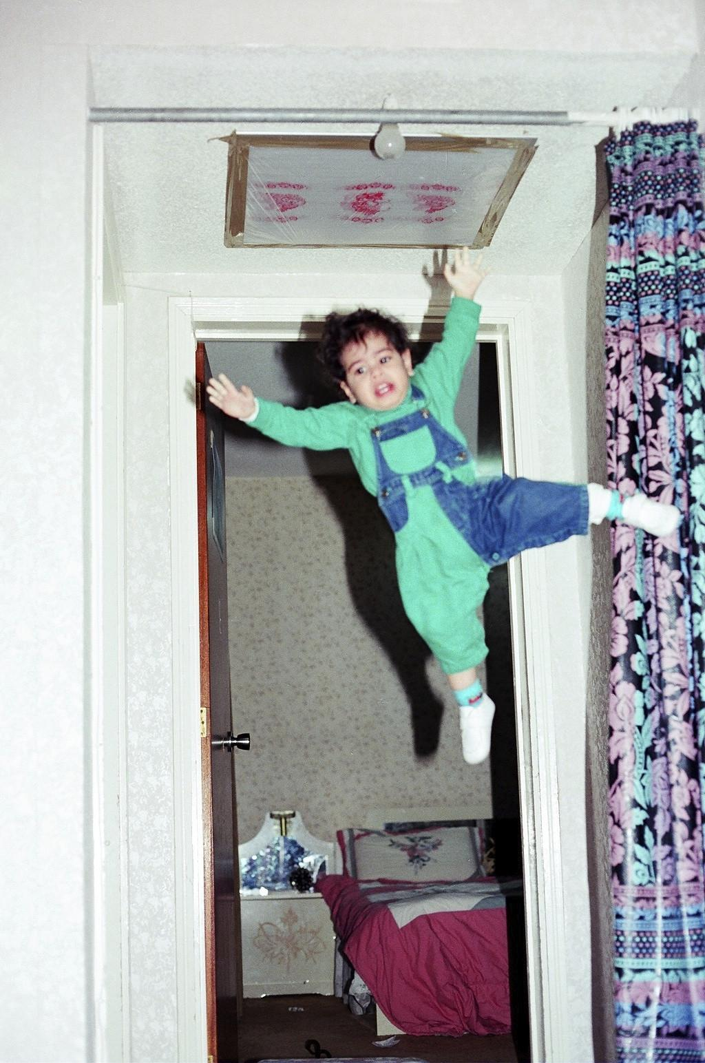 My dad thought 2-year-old me was strong enough to hang from the curtain rod while he takes a picture -   Misc