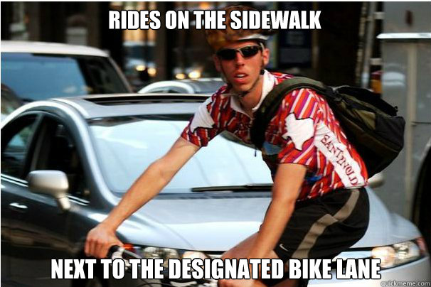 Rides on the sidewalk Next to the designated bike lane