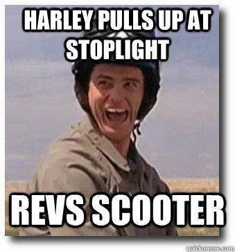 Harley pulls up at stoplight Revs scooter