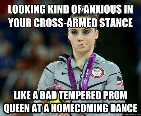 Looking kind of anxious in your cross-armed stance  Like a bad tempered prom queen at a homecoming dance