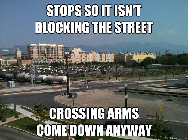 stops so it isn't  blocking the street Crossing arms  come down anyway