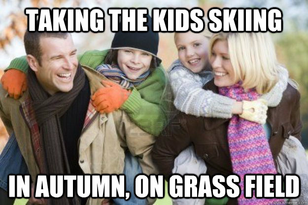 taking the kids skiing in autumn, on grass field