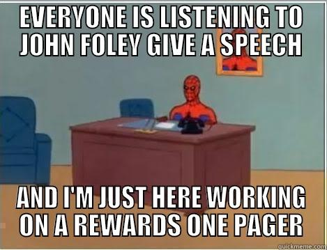 EVERYONE IS LISTENING TO JOHN FOLEY GIVE A SPEECH AND I'M JUST HERE WORKING ON A REWARDS ONE PAGER Spiderman Desk