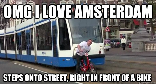 OMG I love Amsterdam steps onto street, right in front of a bike
