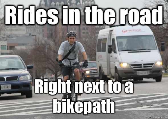 Rides in the road Right next to a bikepath  Scumbag cyclist