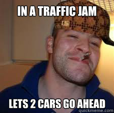 IN A TRAFFIC JAM LETS 2 CARS GO AHEAD