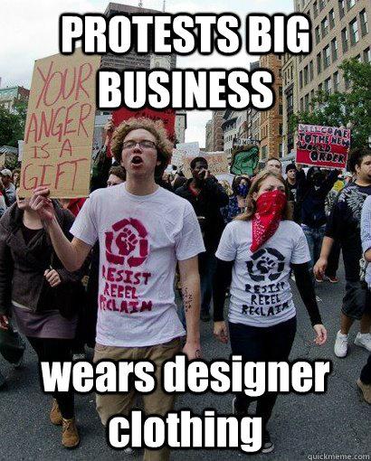 PROTESTS BIG BUSINESS wears designer clothing