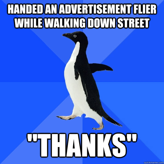 handed an advertisement flier while walking down street