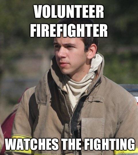 Volunteer firefighter Watches the fighting - Volunteer firefighter Watches the fighting  Early 20s firefighter