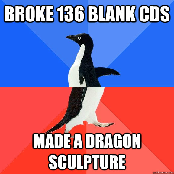 broke 136 blank cds made a dragon sculpture - broke 136 blank cds made a dragon sculpture  Socially Awkward Awesome Penguin