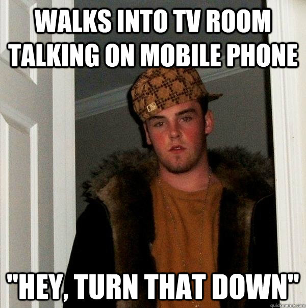 Walks into TV room talking on mobile phone