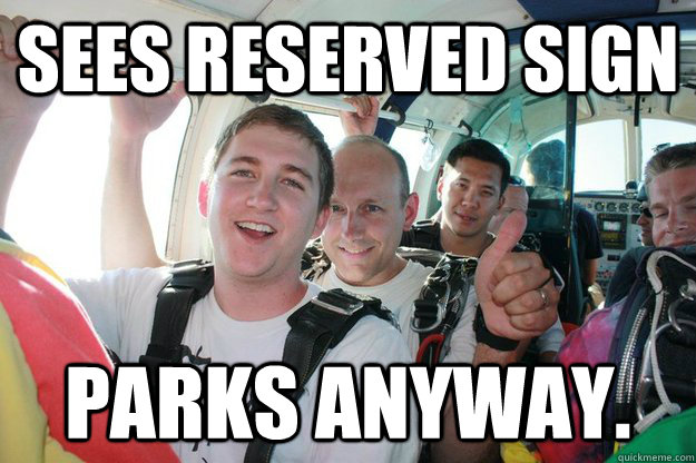 Sees reserved sign Parks anyway.