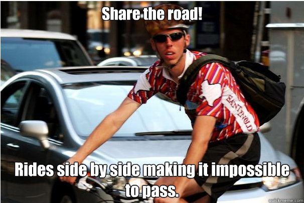 Share the road! Rides side by side making it impossible to pass.