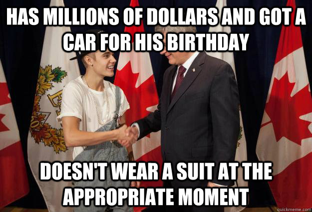 Has millions of dollars and got a car for his birthday Doesn't wear a suit at the appropriate moment