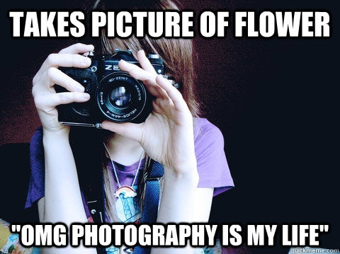 takes picture of flower