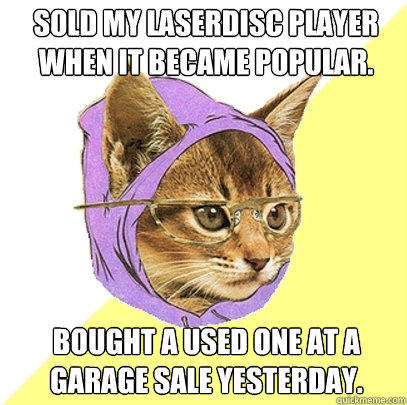 Sold my laserdisc player when it became popular. bought a used one at a garage sale yesterday. - Sold my laserdisc player when it became popular. bought a used one at a garage sale yesterday.  Hipster Kitty