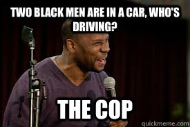 Two black men are in a car, who's driving? The cop