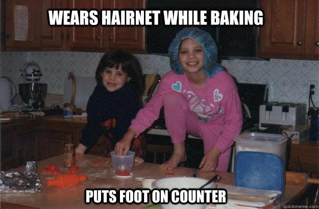 a1071eeda3fdccf9e28d78108d6920f88181c99ef84e2c8bd171e43a5d71eb6d wears hairnet while baking puts foot on counter child logic
