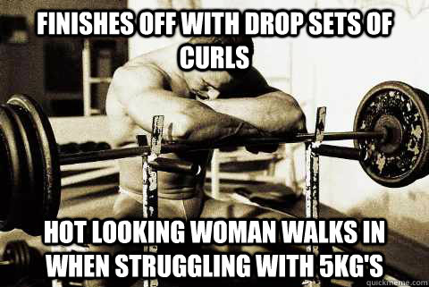 Finishes off with drop sets of curls Hot looking woman walks in when struggling with 5kg's