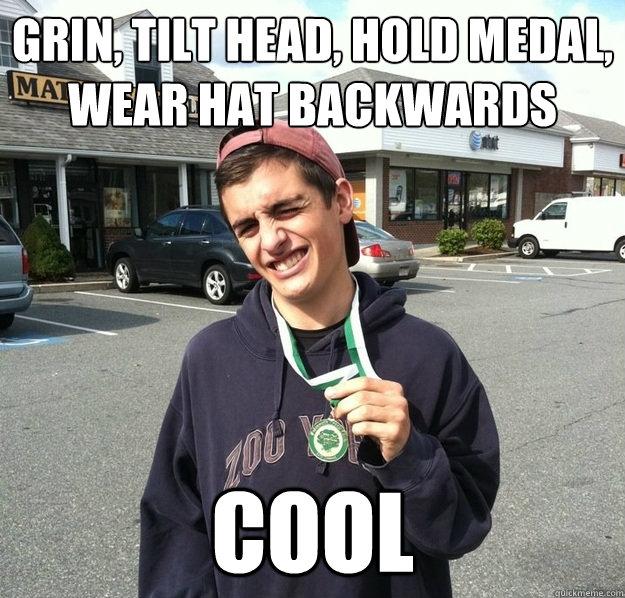 grin, tilt head, hold medal, wear hat backwards cool - grin, tilt head, hold medal, wear hat backwards cool  keith the winner