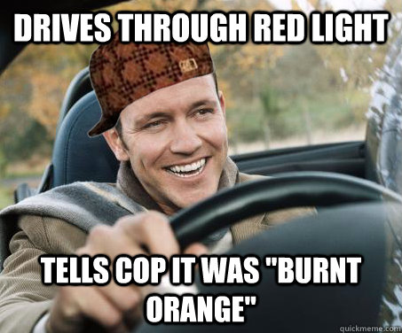Drives through red light tells cop it was
