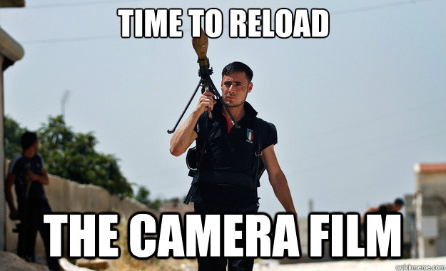 time to reload the camera film  - time to reload the camera film   Ridiculously Photogenic Syrian Soldier
