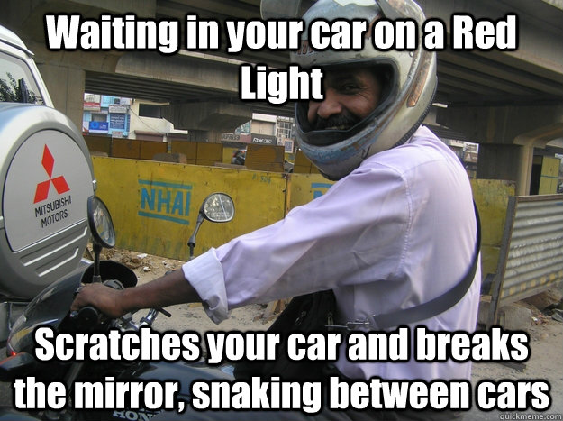 Waiting in your car on a Red Light  Scratches your car and breaks the mirror, snaking between cars - Waiting in your car on a Red Light  Scratches your car and breaks the mirror, snaking between cars  Scumbag bike riders