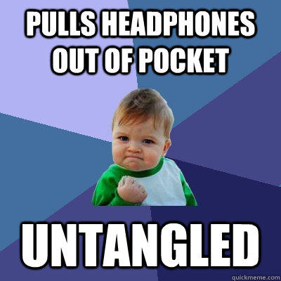 Pulls headphones out of pocket untangled