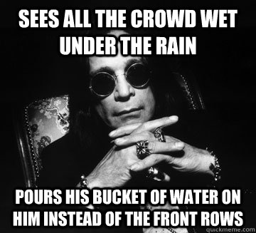 sees all the crowd wet under the rain pours his bucket of water on him instead of the front rows