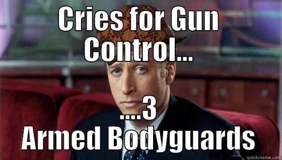 CRIES FOR GUN CONTROL... ....3 ARMED BODYGUARDS Scumbag Jon Stewart