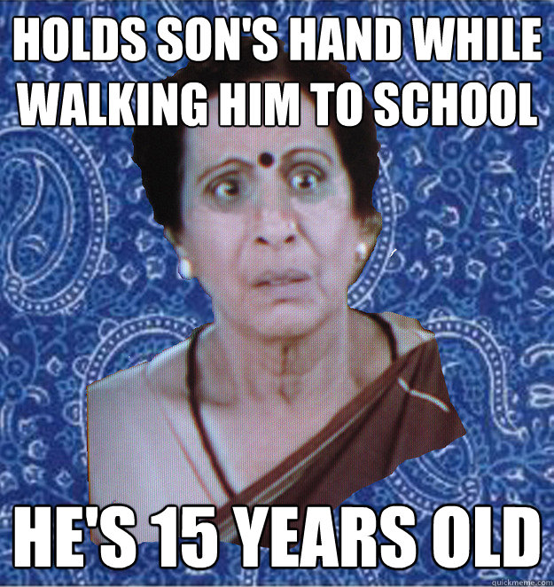 holds son's hand while walking him to school he's 15 years old  Pushy Indian Aunty